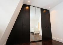 stained oak veneer wardrobe with mirrored doors