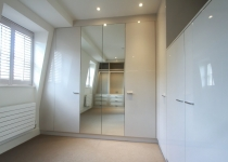 white gloss unit wardrobe with mirrors