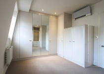 white gloss walk-in wardrobe