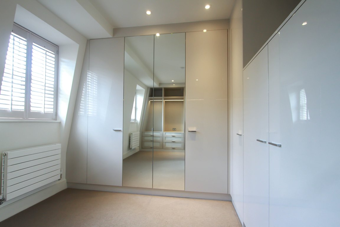 White gloss unit fitted wardrobe with mirrors