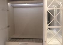Mirrored bespoke wardrobe inside
