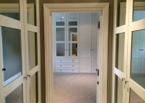 fitted walk-in wardrobe with mirror inserts